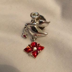 Angel pin with red flower and tiny red star